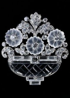 Cartier - An Art Deco brooch, New York, circa 1935. In the form of a basket of flowers, platinum, rock crystals, moonstones and baguette- and brilliant-cut diamonds. #ArtDeco #Cartier #brooch