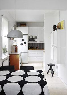 via nice*room / fromscandinaviawithlove:  Kitchen from Finnish magazine Deko.          marimekko table linen
