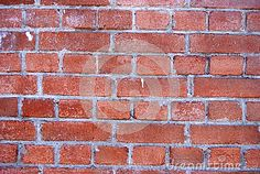 Textured background created by old red brick wall, with rough pointing, in Constanta Romania.