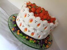 Easy Halloween cake using Peeps Ghosts, jelly beans, candy corn and candy pumpkins on a Carrot Spice cake with cream cheese frosting.