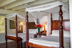 La Bagatelle, St- Lucia | Luxury Retreats - Located near Soufriere's Anse Chastanet beach, La Bagatelle is perfect for those who appreciate lovely natural surroundings and refined touches. Lush green gardens surround this beautiful two-storey villa, while colorful bougainvillea, poinsettias, vincas, and thunbergia climb and hang from all parts of the home. The famous Pitons are in plain sight as is the tranquil blue water of the Caribbean.  Start each day sipping a coffee in a wicker chair…