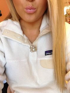 Love that Patagonia pullover and monogram necklace