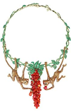Necklace with a pair of monkeys in white & yellow gold set with emeralds, sapphires, tsavorites, onyx & brown diamonds.: