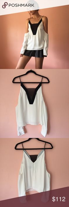 C/MEO Collective Off Shoulder Two Tone Blouse Brush it off in this off shoulder two tone blouse by C/MEO Collective. Features a plunging neck, spaghetti straps, shoulder cutout, long sleeve, black contrast sheer neckline and white loose body. Wear with white trousers or jeans. MSRP $185. New without tags. Fits like an XS-S. Marked size S. No returns allowed. Please ask all questions before buying. IG: [at] jacqueline.pak #cmeocollective C/MEO Collective Tops Blouses