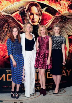 Jennifer Lawrence poses in a white suit with black camisole alongside Julianne Moore, Elizabeth Banks and Natalie Dormer while promoting the Hunger Games in London.