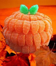 how to make a pumpkin centerpiece from gumdrop orange slices. Good for Halloween, Thanksgiving, or just for fun. Dulces Halloween, Fete Halloween, Homemade Halloween, Halloween Crafts For Kids, Spooky Halloween, Halloween Treats, Baby Halloween, Halloween Pumpkins, Fall Treats