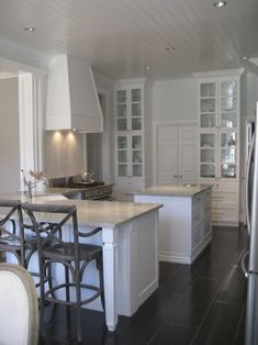 white cabinets, grey counter tops