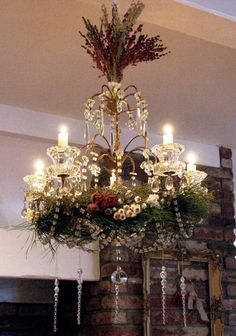 fete et fleur: Beautiful Decoration for December however, I'd like it better without the stuff on top Christmas Open House, Victorian Christmas, Rustic Christmas, Christmas Home, Christmas Holidays, Christmas Villages, Christmas Chandelier Decor, Christmas Decorations For The Home, Xmas Decorations