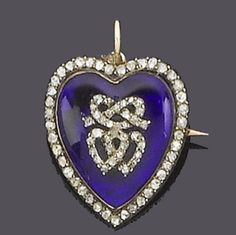 An early 19th century diamond and paste pendant/brooch circa 1810  The blue paste heart with applied rose-cut diamond entwined heart and knot motif, within a rose-cut diamond border, length 2.9cm.