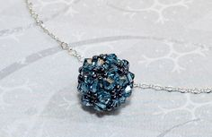 Builds on skills of the basic bead ball by adding seed beads along with crystal beads.