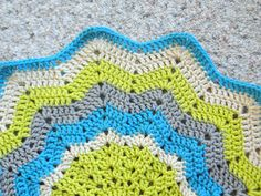 Baby's Round Ripple Blanket by caseyplusthree, using Free Pattern by AngelCrafts, Loops & Threads Impeccable Worsted Yarn -  Solids  in Grass, Aqua, Heather, and Clay.