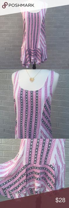 "Free People Asymmetrical Ruffle Hem Dress Free People Asymmetrical Ruffle Hem Dress with ladder stripy back! Love this pink, gray & white pattern! Could also be worn as a tunic! Size Large. 100% Rayon. Laying flat its approximately 32"" inches long at the shortest point of the hem, & 33.5""inches at the longest. Previously loved, slightly faded & back straps are wrinkled & need to be ironed. Free People Dresses"