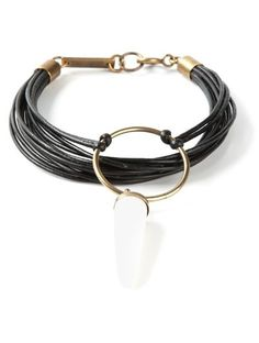 'Off-white buffalo leather and cattle horn shark bracelet from Isabel Marant featuring brass hardware, a spring-ring fastening and a gold-tone logo plaque.'
