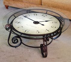 The Analog Clocktail Table - Hammacher Schlemmer This link takes you to the store where you can buy this, but I think I could use it as inspiration to reinvent an old coffee table I already have that has a round glass center. Apartment Furniture, Diy Furniture, Furniture Design, Modern Furniture, Hammacher Schlemmer, Vintage Coffee, My Dream Home, Decoration, Cool Designs