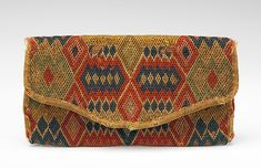 Clutch Purse: Designed by Deborah Hill in the fourth quarter 18th Century. American. Made of wool, linen and silk. The envelope style and diamond pattern is still in fashion today. I would love to have this piece in my collection.