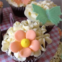 Carrot cake cupcakes with cream cheese icing & decorations.