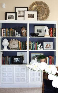 next bookshelf system paint back an accent color.  something with bottom storage/cabinets