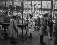 Cases of Chinese porcelains and Museum visitors, photographed on May 31, 1913