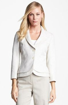 Cropped jacket with curved edges - very Armani-esque, and shades of white, cream & beige.  Feminine, elegant, and classic.