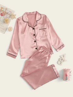 Style: CasualColor: PinkPattern Type: PlainNeckline: NotchedType: Pajama SetsDetails: Button, PocketSleeve Length: Long SleeveComposition: Polyester, SpandexMaterial: SatinFabric: Fabric has some stretchSheer: No Cute Pajama Sets, Cute Pajamas, Pj Sets, Cute Sleepwear, Sleepwear Women, Pajamas Women, Girls Pyjamas, Cute Lazy Outfits, Girly Outfits