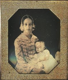 mother and her dead child... After staring at this for a minute, I am wondering if the mother is PM as well because her eyes do not look natural, but more like they have been painted on over her eyelids.