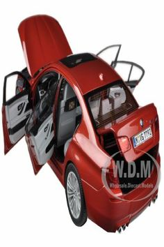 Brand new 1:18 scale diecast model of 2012 BMW M5 (F10M) Sakhir Orange die cast model car by Paragon Models. Brand new box. Rubber tires. Made of diecast metal. Detailed exterior, interior, engine compartment. Dimensions approximately L-10.5, W-4, H-3.5 inches. 2012 BMW M5 (F10M) Sakhir Orange 1/18 Diecast Car Model by Paragon. Bmw Models, Rubber Tires, Model Car, Diecast Models, Bmw M5, Engine, Scale, Exterior, Orange