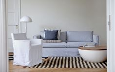 Loose Fit Urban on sale until March 16/2015. Karlstad 3 seater sofa cover, Loose Fit Urban style, in Sandhamn Stripe Black/White. Karlstad armchair cover, Loose Fit Urban style, Absolute White Rosendal Pure Washed Linen. Cushion covers in Indigo Brera Lino and Cloud Brera Fino. www.bemz.com