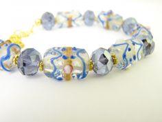 Glass bead bracelet w purple crystals