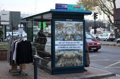 Artists take over Paris bus stops with anti-adverts against climate change