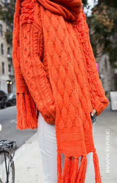 Cozy oversized scarf + vibrant orange hue = perfect winter accessory. Bundle up in layers of cable knit and fringe with this fuzzy scarf that was made for wintry winds. Wear it to the office, or on the weekend with a matching sweater for an extra dose of color with white denim on bottom. Winter wardrobe woes solved.