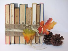 Stamp the edges of old books and wrap with festive twine or ribbon for a bookish Thanksgiving centerpiece