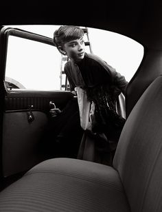 """TOKI-NO-WASUREMONO Current Exhibition  Hepburn, Audrey, 1953 Audrey Hepburn getting into a car after her first photo shoot at Paramount, having recently finished her first film """"Roman Holiday,"""" 1953. (A120)"""