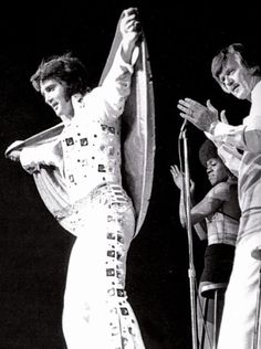 Elvis and J.D. Sumner on stage. Elvis looked up to J.D. and often went to him for spiritual advice.