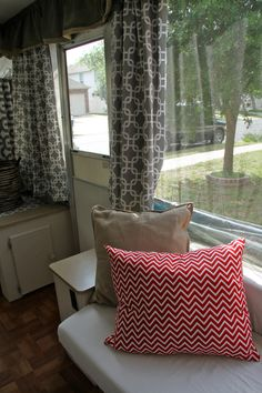 Remodel of tent camper! New curtains and paint and drawer pulls and pillows!