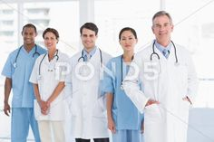 Portrait of doctors in a row at hospital Stock Photos ,