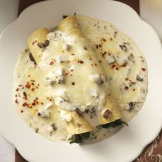 "Spinach Mushroom Enchiladas {Taste of Home}..""Lime, cilantro and Jack cheese lend Mexican flavors to this veggie-filled version of a real crowd-pleaser."""