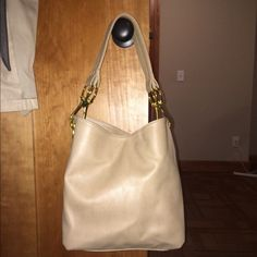 "NWOT Tan purse NWOT. Never-been-used tan purse with gold hardware. Multiple organizational zippered pockets and slots inside. Approximately 12""x12""x5"" Braciano Bags Shoulder Bags"