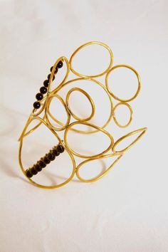 Bubble Cuff. Gold-plated brass with semi-precious onyx beads.