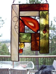 Created with earth toned stained glass, glass nuggets and an agate slice.