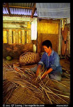 Woman weaving a toga (mat) out of pandamus leaves. American Samoa (color)