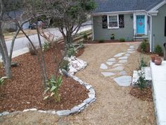 Landscape Designer: John Bowles of New Leaf Landscape Designs in Fayetteville, NC. Front yard landscape design: natural stone wallkway using flagstone. side yard bed design: mulch, cannas, small rock border.