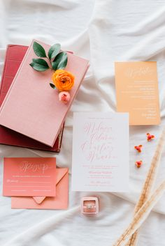 Wedding invitation suite using hand calligraphy. Invitation colors include peach, white, soft yellow, & salmon. Styled on a white backdrop with orange & pink florals, a Mrs. Box, & stamps. Photography by Morgan Lee Portraits. Planning by Plan it Terra. Industrial Wedding Venue: Mercantile Event Center in Boonville, Missouri. Near Columbia, Missouri.  #weddinginspo #missouriweddingplanner #missouriweddingphotographer #invitation #weddinginvite #calligraphy #flatlay #weddinginvitation