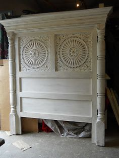 Custom headboard using porch posts and tin ceiling tiles. looks like a bit of crown molding as well. image only, no further directions