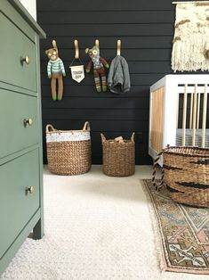 Bold black wall with baskets and green dresser in gender neutral nursery - Toptrendpin Baby Boy Rooms, Baby Boys, Toddler Rooms, Toddler Bed, Baby Boy Nurseries, Nursery Room, Kids Bedroom, Green Boys Room, Green Boys Bedrooms
