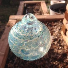 A personal favorite from my Etsy shop https://www.etsy.com/listing/256121569/handmade-glass-hanging-ball-ornament