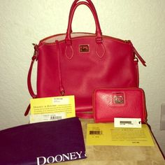 Strawberry Dooney & Bourke Satchel, dustbag Wallet Beautiful Strawberry D&B Satchel w/dustbag & matching zipper wallet & excellent condition. The satchel has 2 corners on the very bottom showing minor scuff but not noticeable (see picture). Inside is flawless, & wallet is flawless. Both come with original tags & authenticity registration cards. Satchel $278; wallet $165 Dooney & Bourke Bags Satchels
