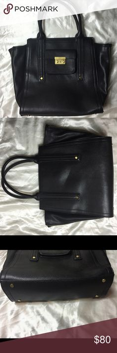 """3.1 Phillip Lim Black Pashli ShoulderBagTote Purse Women 3.1 Phillip Lim for Target Large Black Pashli Shoulder Bag Tote Purse. - black textured faux leather with gold tone hardware - Gusseted sides w/ logo stamped zipper pulls - interior is black twill fabric, with one inside zipper pocket and two other smaller pockets for cell phone or sunglasses - top zipper closure  measures approx 13"""" x 16"""" x 5"""" with a handle drop of 8""""   We are a non-smoking house!      3.1 Phillip Lim For Target In…"""