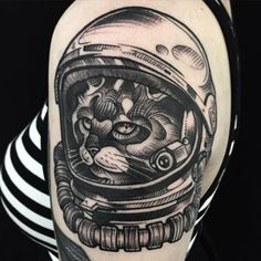 Cool astronaut cat tattoo on shoulder.