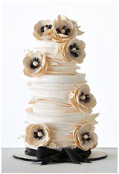 Magnolias Tucked Away in Soft Folds Wedding Cake