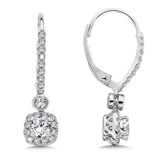 Diamond drop earrings with center stone surrounded by a cushion-shaped diamond halo in 14k white gold.